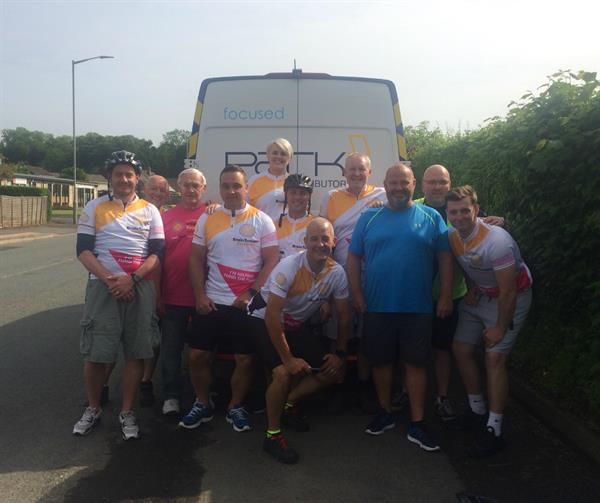 Man living with brain tumour completes bike challenge with friends and relatives