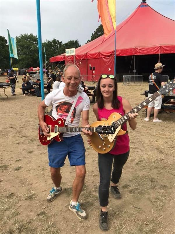 Father and daughter take part in electrifying guitar challenge for research into brain tumours