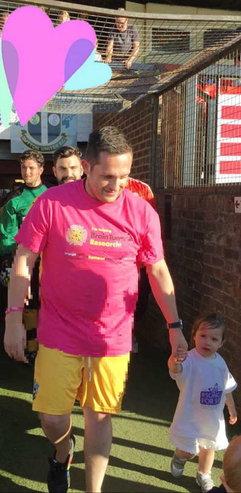 Two-year-old leads out teams for charity football match in memory of grandmother