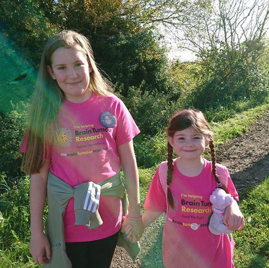 Phoebe and family walk for charity after brain tumour loss