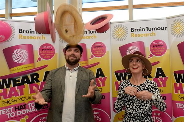 "Cancer patient ""inconvenienced"" by brain tumour gets her hat on to help find a cure – and meets model and fellow survivor Caprice"