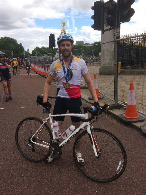 Dad's brain tumour diagnosis inspires son to smash fundraising target in charity cycle challenge