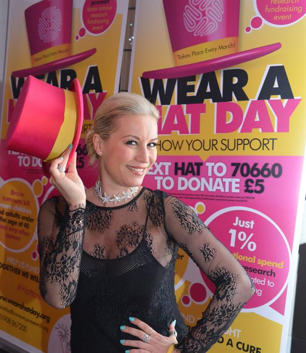 Denise van Outen wearing pink top hat