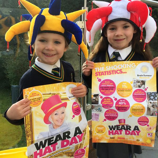 Wear A Hat Day - Two children wearing hats hold up posters