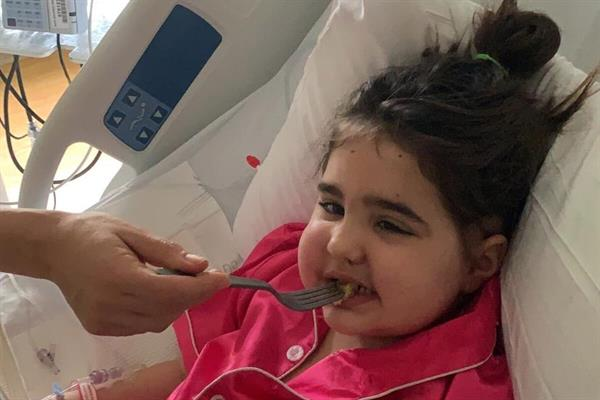 Edie and family beat travel ban to fly home after lifeline brain tumour treatment in US