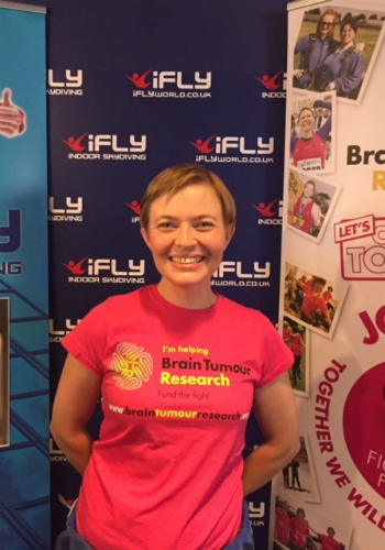 Ali Herbert in front of Brain Tumour Research banner