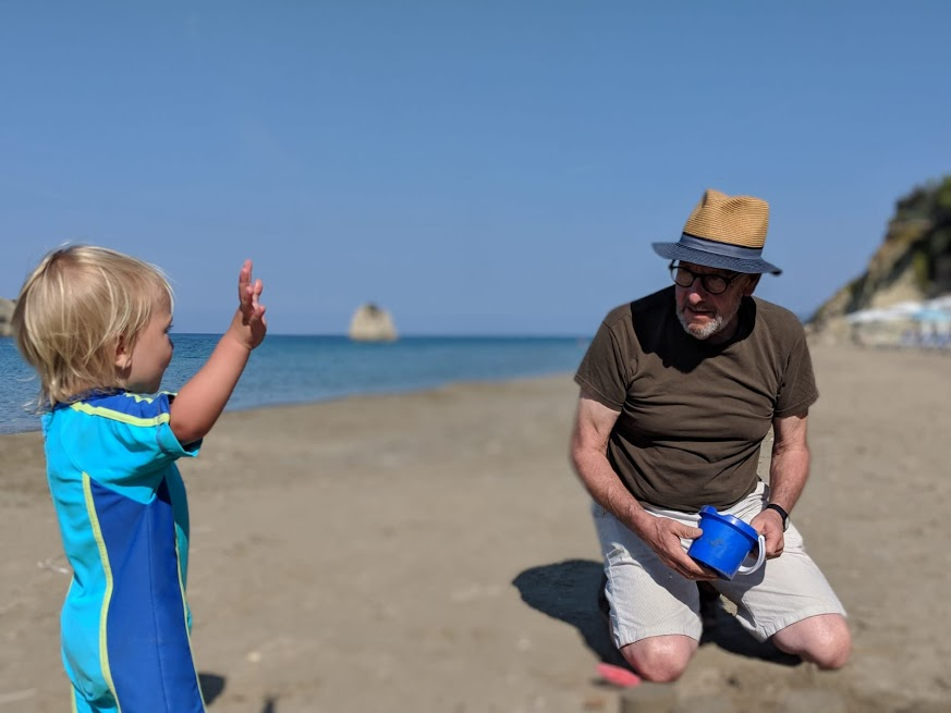Mick and Grandson on a beach