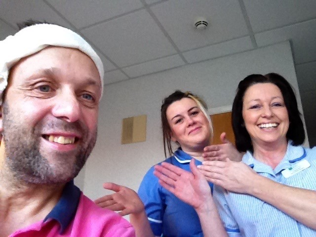 Richard in hopsital with two nurses