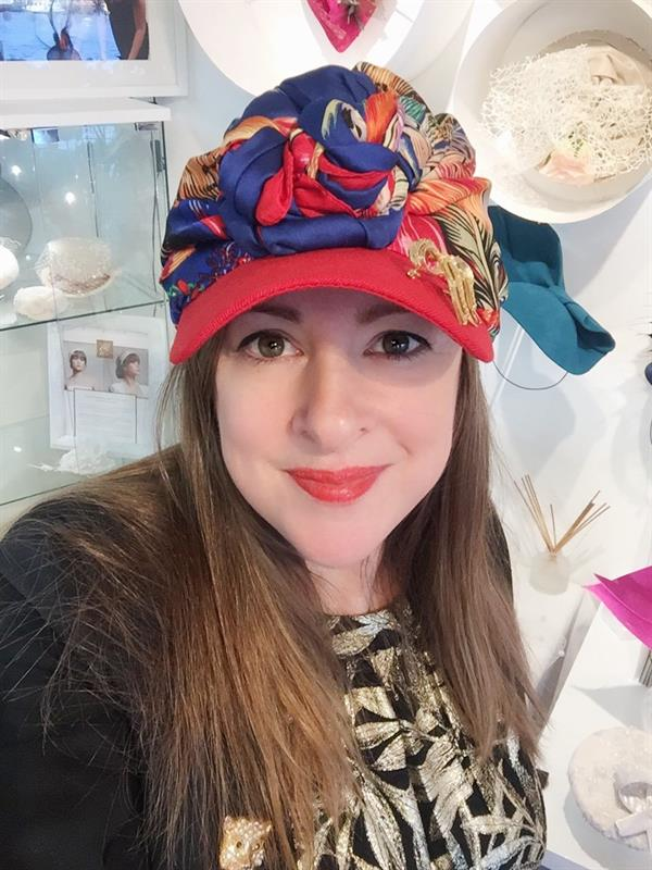 Luxury hat designer supports research into brain tumours